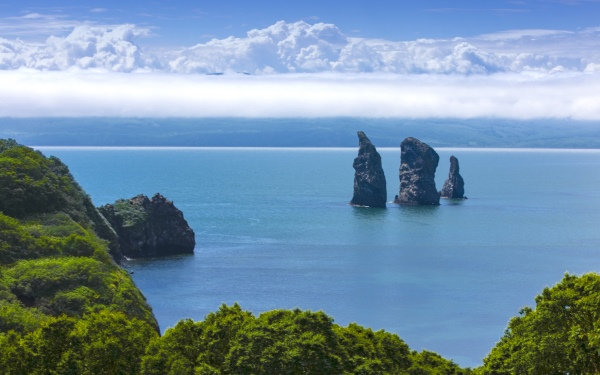 Three Brothers Rocks in the Avacha Bay of the Pacific Ocean. The coast of Kamchatka