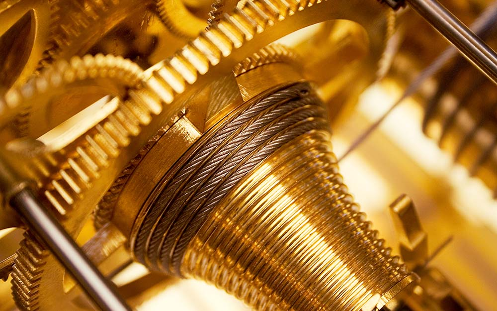 close view on golden cogs and wheels.